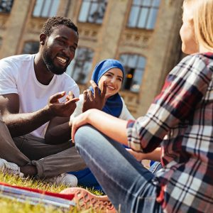 Diverse students sitting on campus