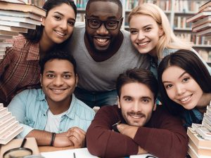 Diverse students sitting in library