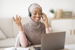 online-education-young-black-female-teacher-hijab-having-video-lesson-students-using-laptop